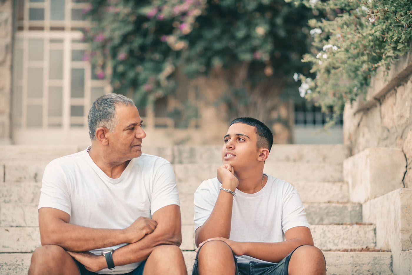 teen son talking with dad
