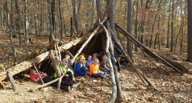 Kids in woods learning about outdoor education